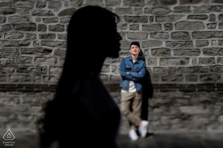 China engagement portrait of a couple against a stone backdrop