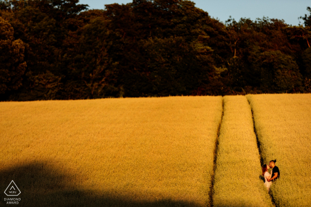 Engagement shoot with couple in the fields at sunset in Patrixbourne, Kent, UK