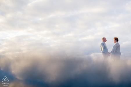 Ritratti di Key West della Florida - coppia con le riflessioni della nuvola