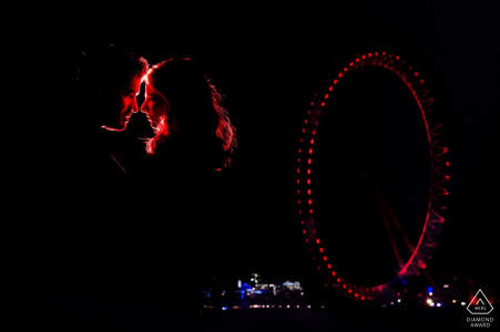 London Eye Engagement Photo Shoot at Night with Couple in Red