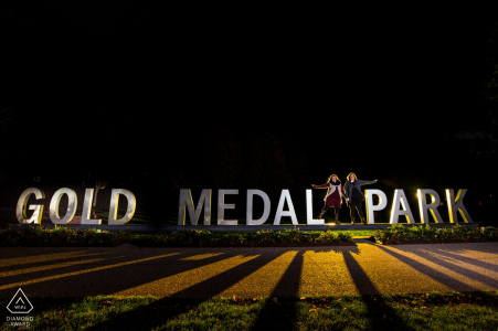 Couple by the gold medal sign | Minneapolis Engagement Photographer
