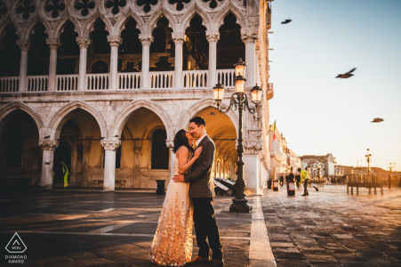 Venice engagement photo of couple in a public square