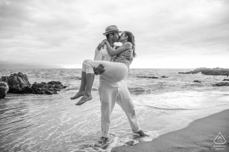 Puerto Vallarta, Mexico engagement portrait on the beach - she said yes and he carries her in the rising tide