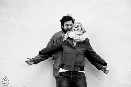 London | UK pre-wedding engagement Photography session with a couple against a white wall