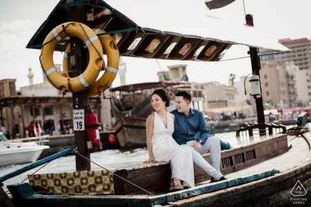 Abra Ride on Dubai Creek - UAE engagement portrait session on the water in a boat