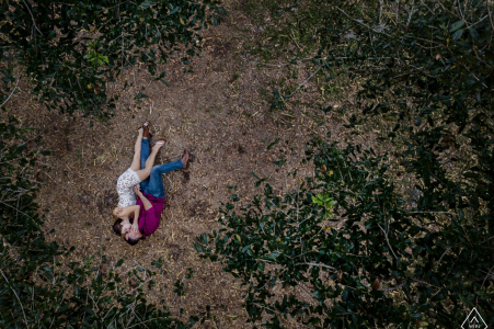 Key West engagement photo shoot | Tree top view from a drone of a couple lying on the floor of the forest