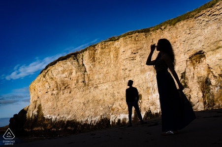 Shark Fin Cove Pre-Wedding Portrait - Couple's silhouette against the oceanfront cliffs