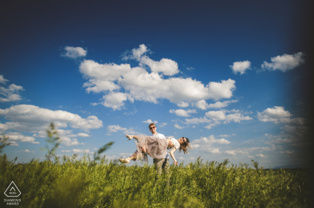 An engaged couple during their Engagement Photo Session in Crete Senesi, Tuscany