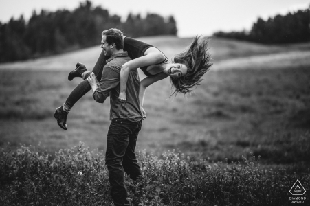 This engaged couple is having fun outside during their pre-wedding shoot in Edmonton, AB, Canada