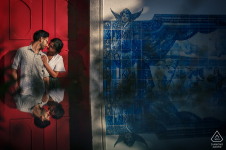 This creative portrait using the couples reflection at the Lisbon tiles was designed by a Portugal engagement photographer