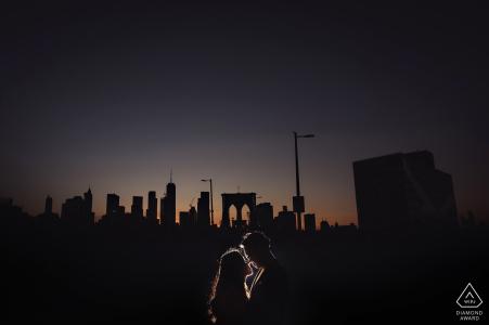 Brooklyn Bridge engagement couple portrait at night