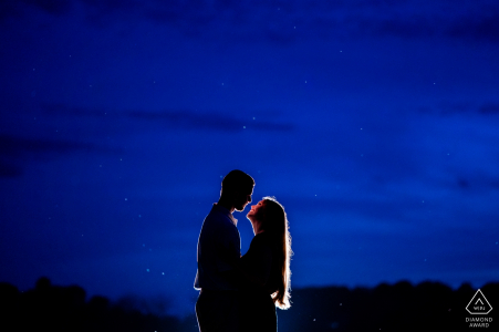 Rixey VA Farm Engagement Portrait session - The couple embraces after sunset and the sky is illuminated