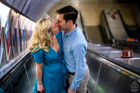 London Underground Escalators - Couple kissing on the escalator during engagement shoot
