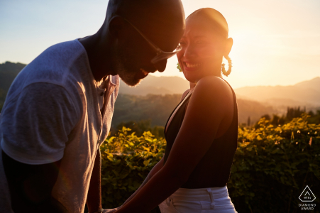 Lucca tuscany engagement portrait just before sunset with laughing, fun couple.