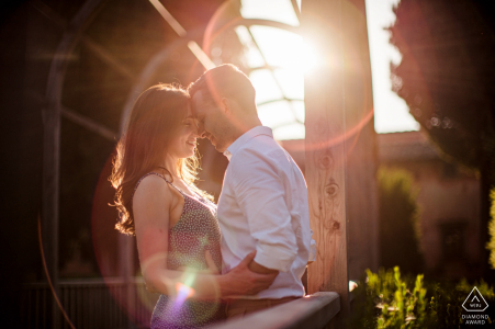 Engaged couple is immersed in the flares generated by the sun during this prewedding shoot at Vigna Maggio Resort