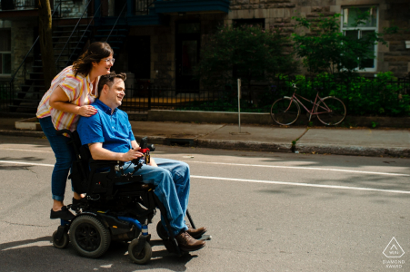 Montreal, Quebec Engagement Session with a ride around their neighbourhood on the back of his wheelchair.