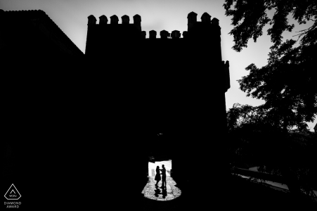 Toledo, Castilla-La Mancha medieval door silhouettes of engaged couple during portrait session in Spain