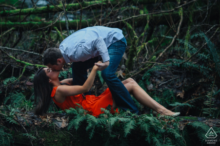 Bonney Lake, WA couple kissing in the forest and having fun during portrait session