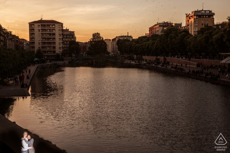 Milano, Italy engagement photo at sunset at the water with a solo light