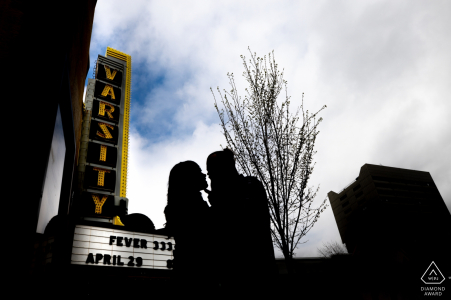 Minneapolis Couple silhouette by theater sign during engagement portrait shoot.