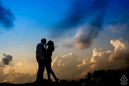 Lincoln memorial Washington DC engagement portrait photographer created silhouette of couple standing on ledge