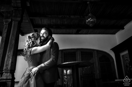 Couple enjoy a minute in the historical building of Hanul Lui Manuc during black and white engagement photo session