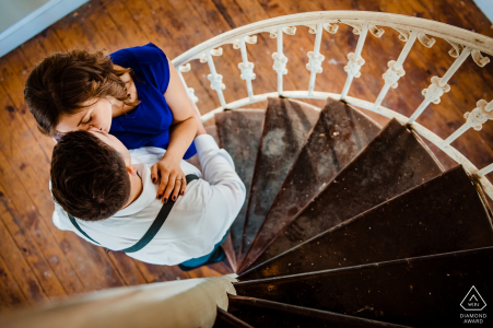 Steinway Mansion Engagement Session - Photo of a Kiss on the stairs
