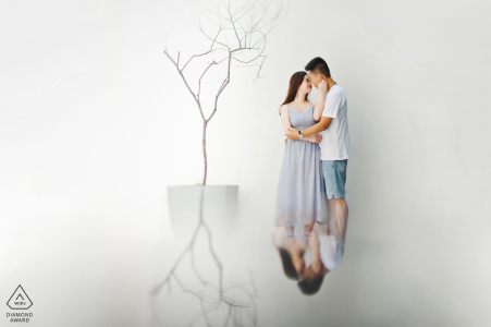 Engagement Photos from Nanping Fujian - Portrait contains: couple, embrace, hotel, tree, reflection, white