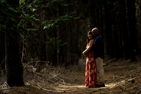 Engagement Photography in a Forest in Alta, California | Sunlight creeping through the trees to illuminate the engaged couple