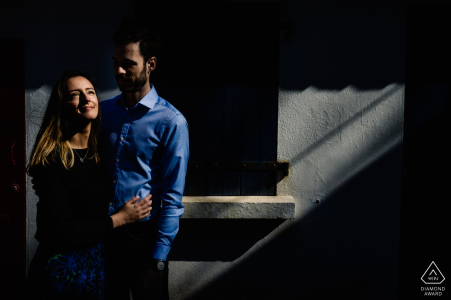 Engagement Portrait from Biarritz, France - Image contains: Light on the couple, shadows, blue