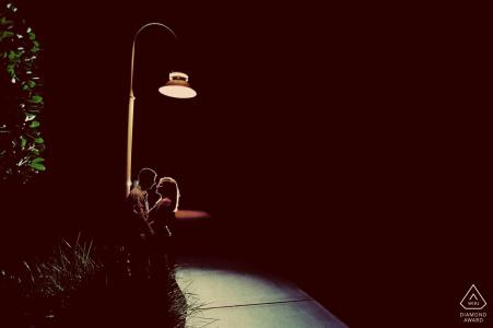 Engagement Photographer for Key West, FL - Portrait contains: street lamp, couple, sidewalk, night