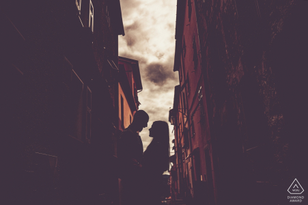 Engagement Portrait from Bolano - Photography contains: couple, buildings, town, silhouette