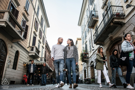 Engagement Photography for Milano, Italy - Image contains: town, street, pedestrians, buildings, couple, engaged, walking