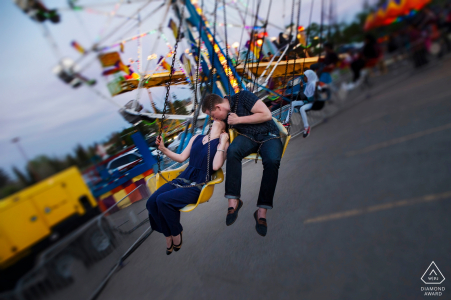 Engagement Photos from Local fair in Edmonton - Couple rides the swings at fair