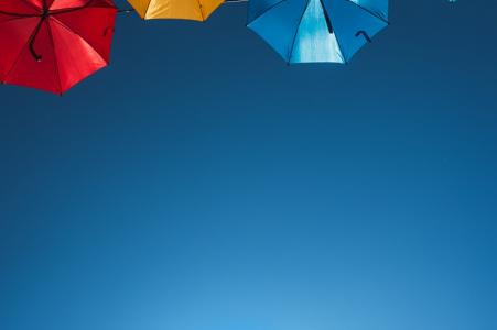 Bordeaux, France colorful umbrellas overhead in this engagement portrait of a couple