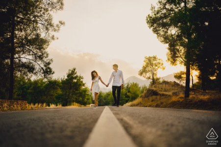 Cyprus engaged couple walking in the road during portrait session