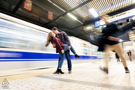 Edmonton, Alberta Couple kiss as train goes by during prewedding portrait photo session