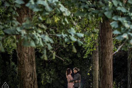 Milano, Italy engagement photo of a couple in the tall trees