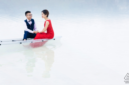 Chaka Salt Lake pre-wedding session in a transparent boat on a lake in Qinghai