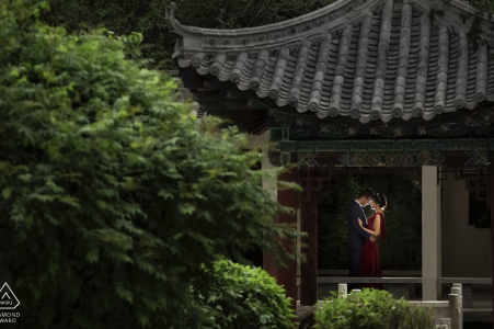 Newly engaged couple embrace each other in the pavilion in the backyard of Xining Hotel, Qinghai