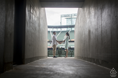 Camden Yard, Oriole Park, Baltimore, MD - Couple is becoming part of the geometry during their Camden Yard engagement session, a lifelong dream for them.