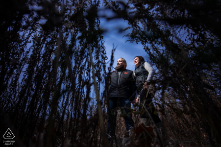 Minnesota engagement session in Silverwood Park - Couple in the tall grass with a blue sky behind them