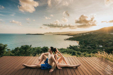 Samujana Villas, Koh Samui Engagement Shoot on the wood deck in bathing suits | The couple were embracing the nature surrounding and waiting for the sunset.