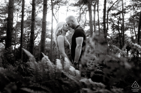 Chicksands Wood, UK Engagement Portrait Session - Image contains:face, facing, each, other, trees, sunlight, ferns