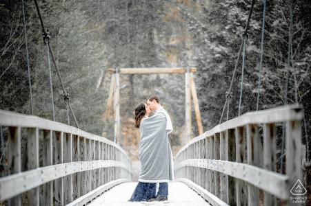 Massachusetts Engagement Couple Portrait - Image contains: snow, covered, bridge, blanket, cold, winter