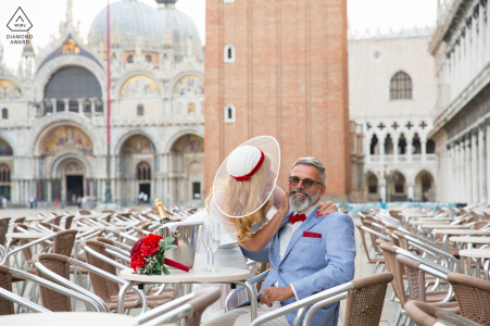 Engagement Portrait of a Couple - Image contains:A couple sitting at the Cafe Florian in Piazza San Marco