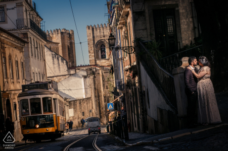 Alfama, Portugal Engagement Photography - Portrait contains:cable car, trolly, streets, train, light, sun