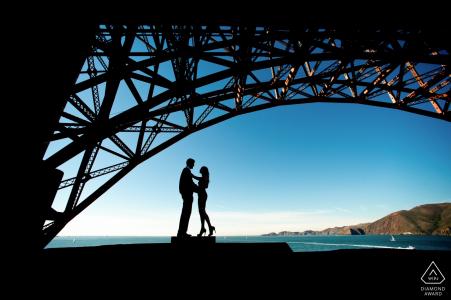 San Francisco, CA Silhouette under the Golden Gate Bridge. Engagement Couple Photography - Portrait contains:SF, CA, water, bay