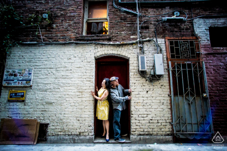 San Francisco, CA engagement Image of a couple in a Chinatown alley.