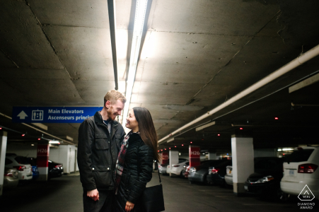 Ontario, Canada Couple Engagement Portrait - Image contains:pause in the parking lot, underground, garage, cars, lighting, concrete